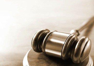 Registrazione sentenza: su chi grava l'imposta di registro?