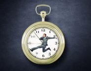 49534868 - concept of time with funny businessman running in a hurry